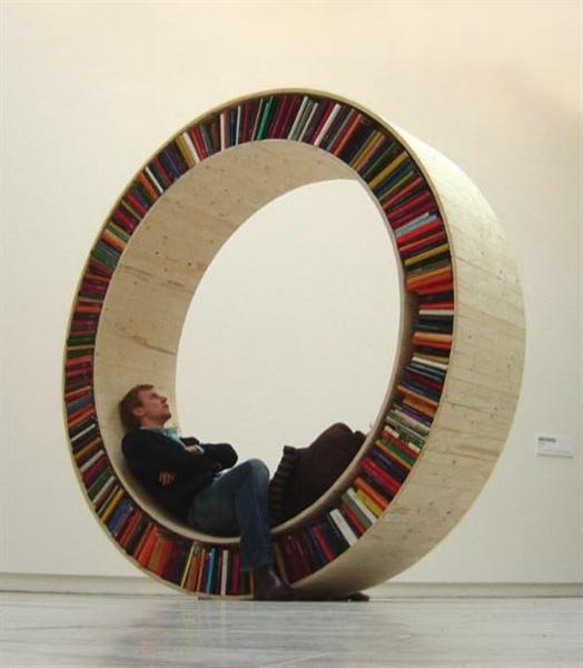 http://cdn.makezine.com/make/blogs/blog.makezine.com/2011/03/04-circular-bookshelf.jpg