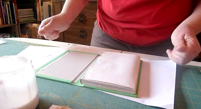 A picture of a step in the DIY casebinding process for handmade hardback books
