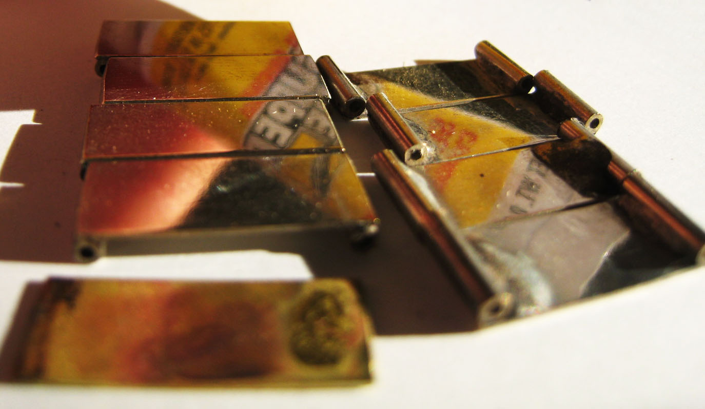 Soldered brass hinge leaves, before plating.