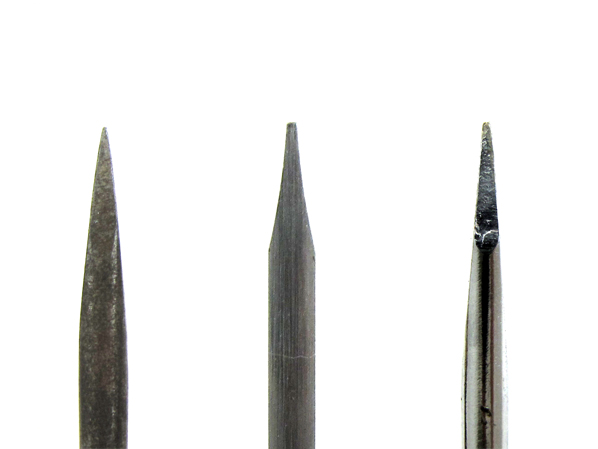Medium-sized GW gunsmithing screwdriver (center) with two other random flat-head screwdrivers from the drawer.