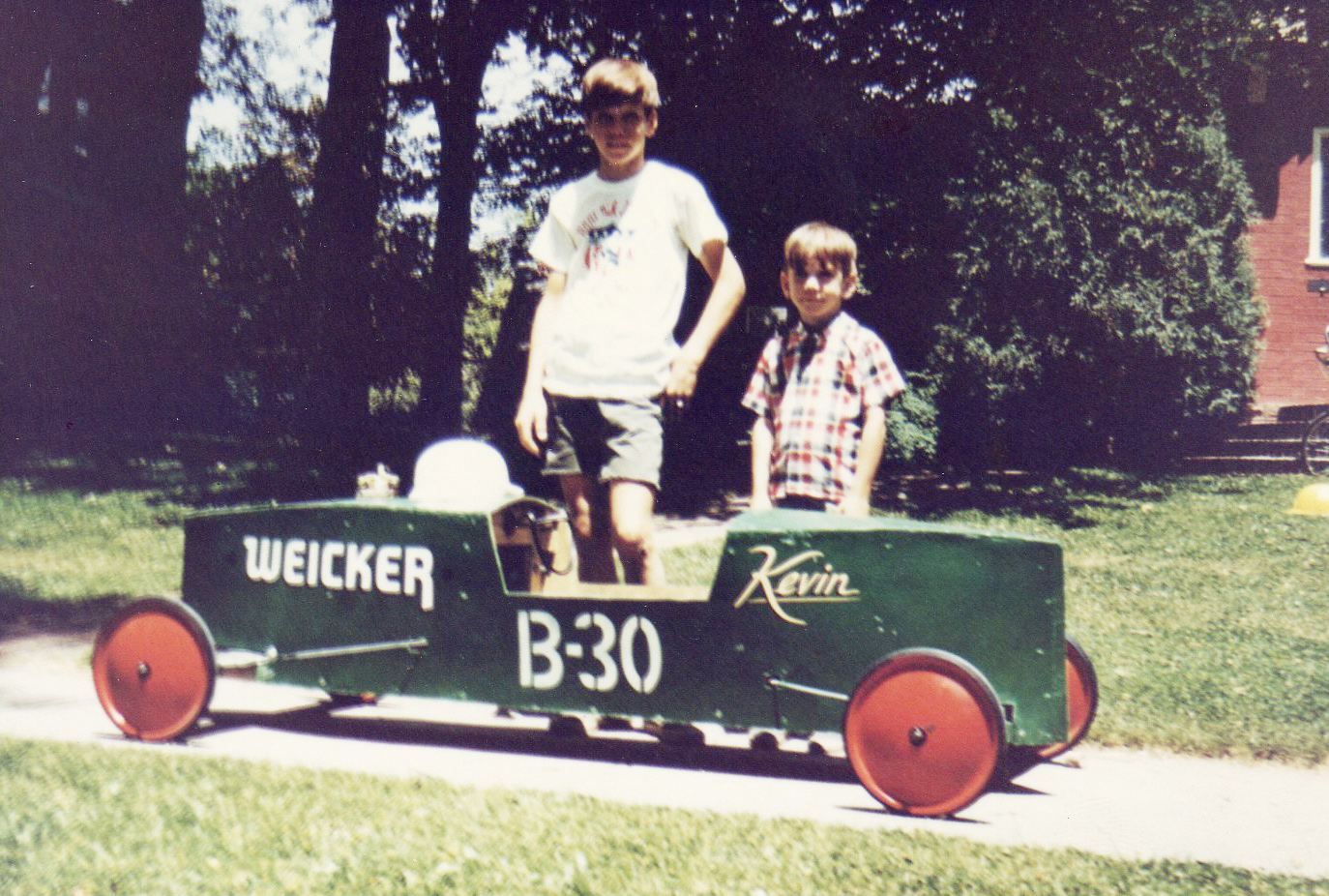 Kevin Berry (left) and the author posing in front of another of his racers.