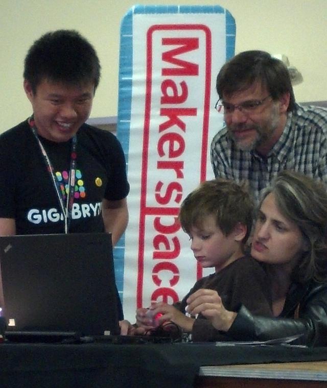 Aiken programs a wearable LED box.