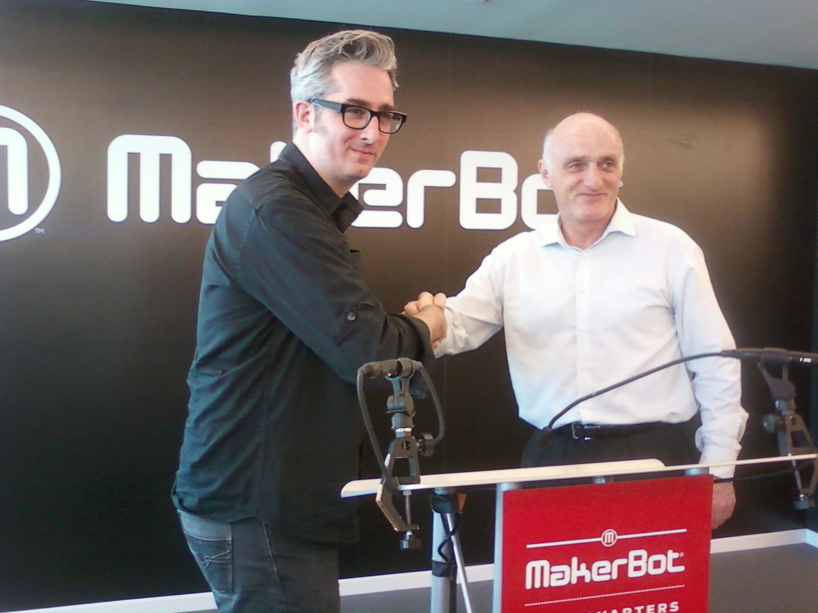 Bre Pettis of MakerBot Shakes hands with David Rice of Stratasys
