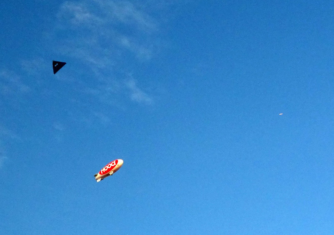Up in the skies: an airplane, a blimp, and the Brooklyn Aerodrome flyer.