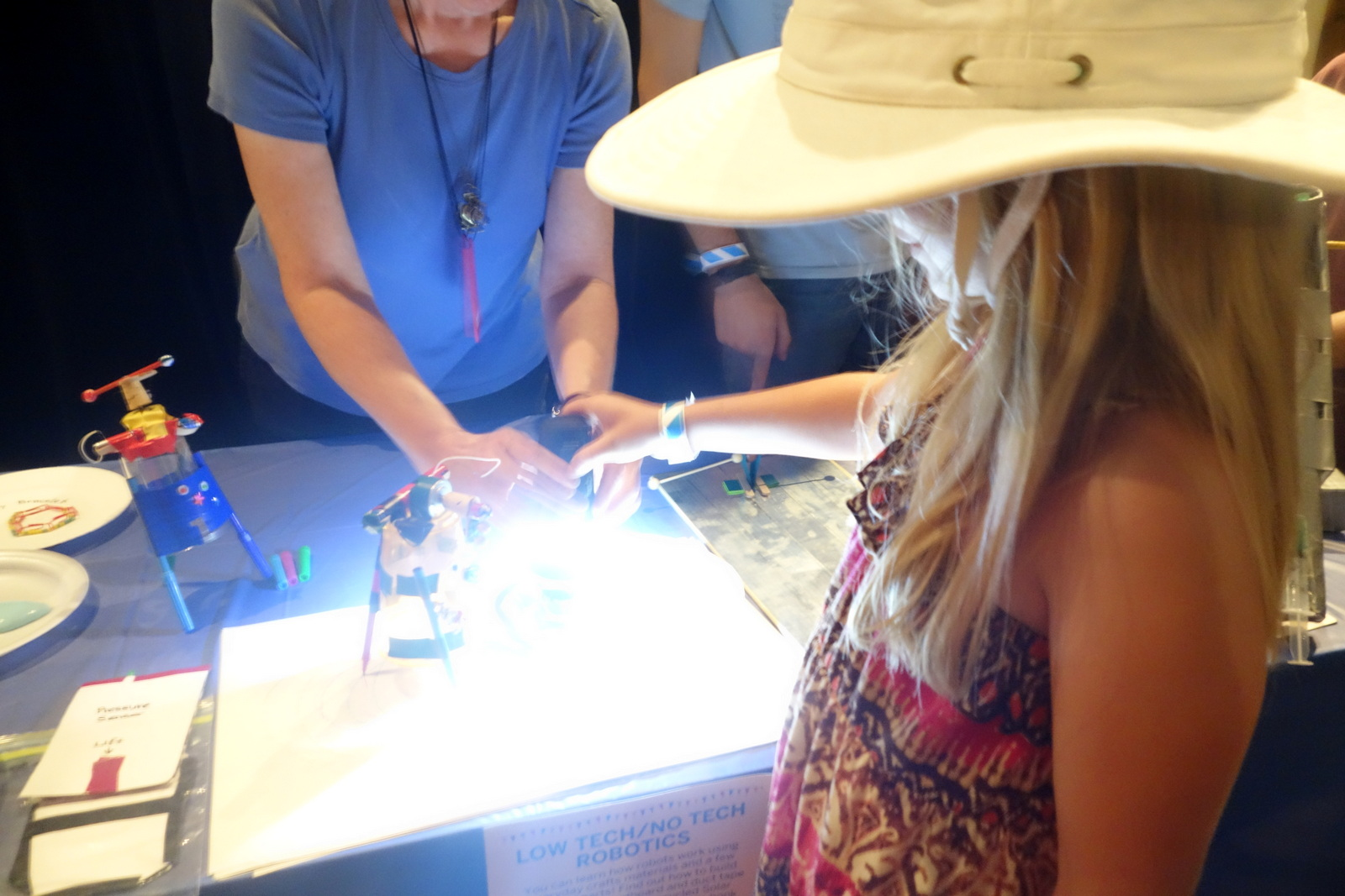 """Kathy Ceceri demonstrates a """"Low Tech/No Tech"""" solarbot made from cheap materials like discarded CDs and food containers."""