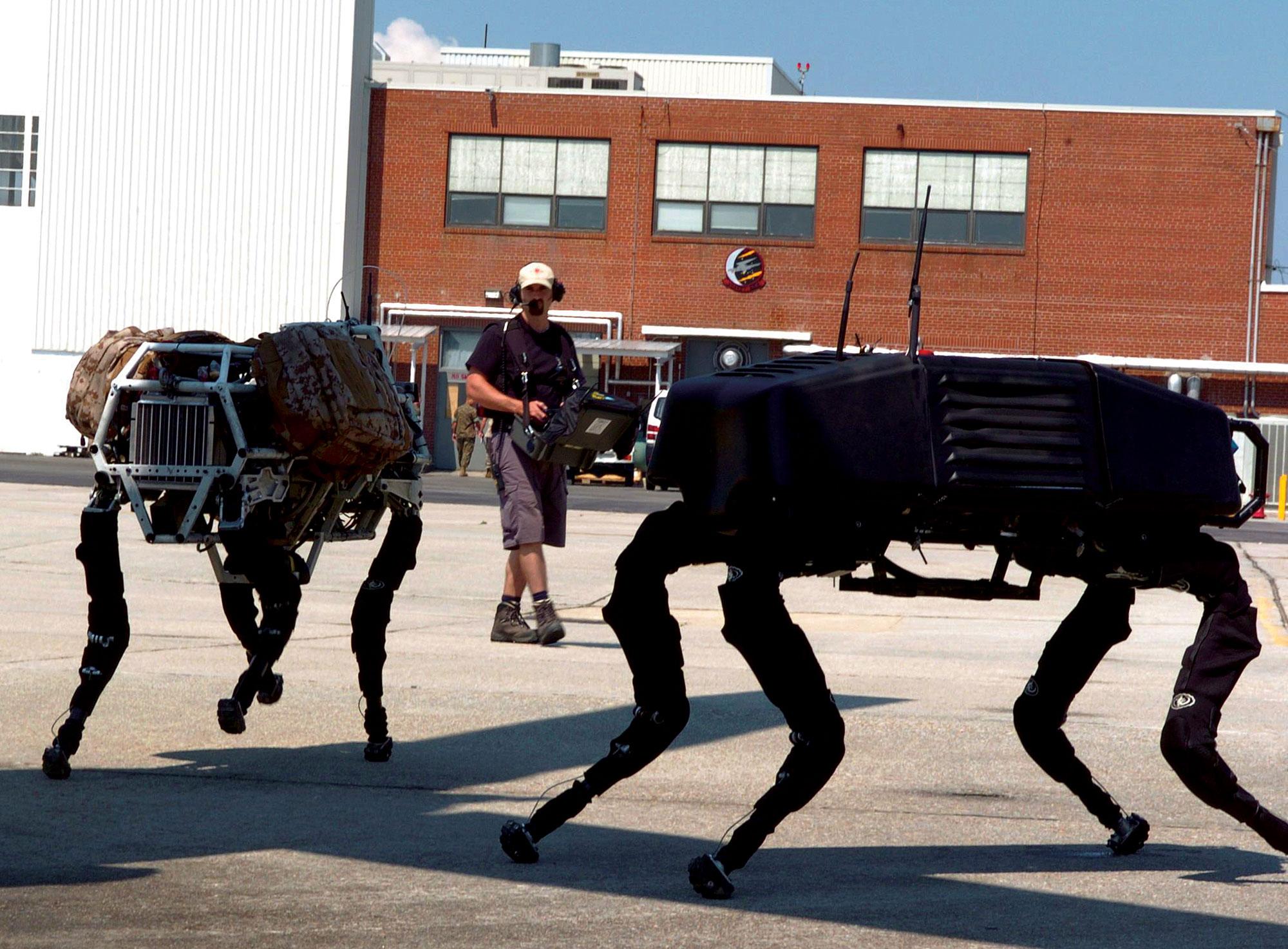 Boston Dynamics BigDog robots operating under remote control.
