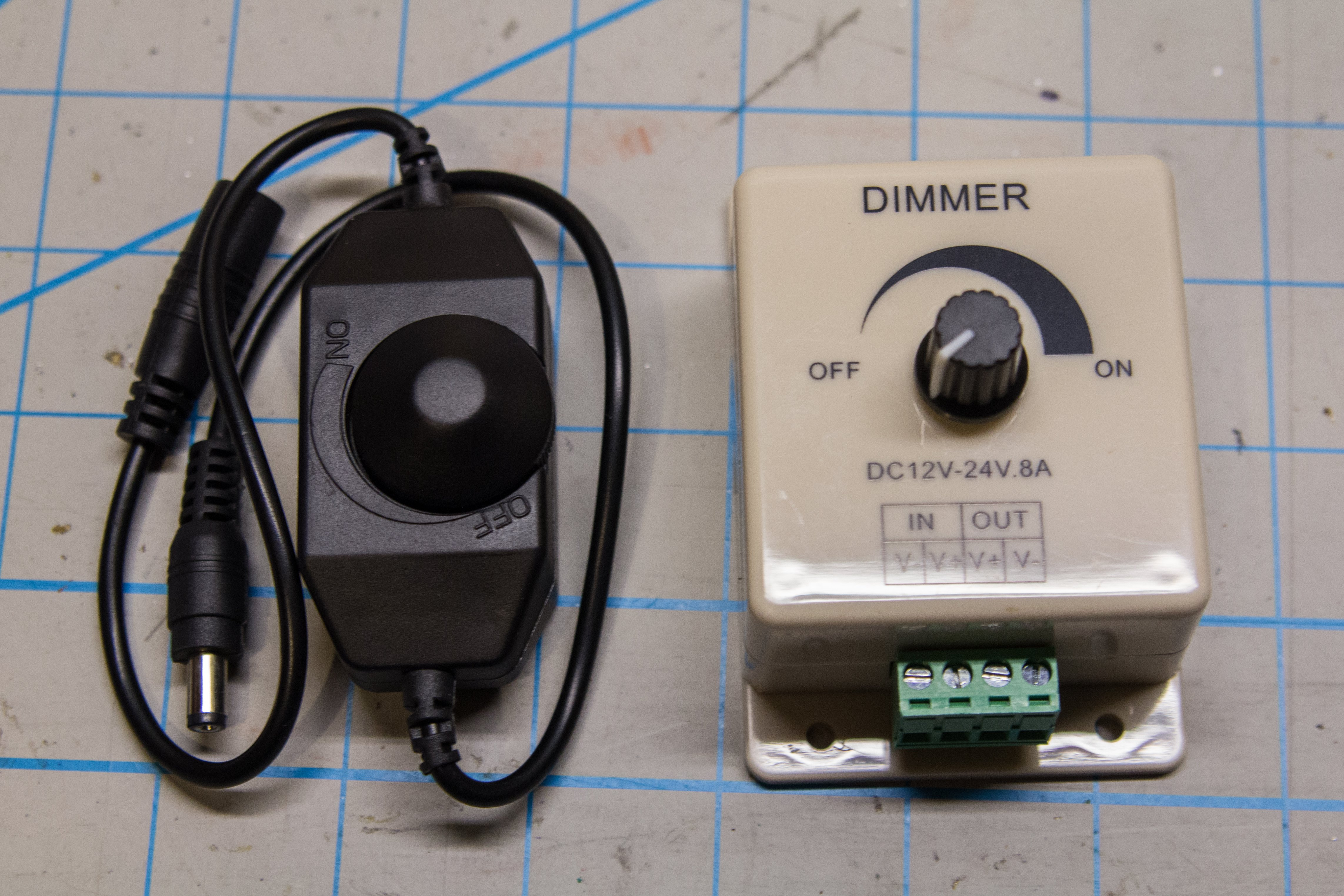 The dimmer on the left is an inline dimmer that comes with many LED kits. It is unsuitable for video use. The one on the right is much better suited for our needs.