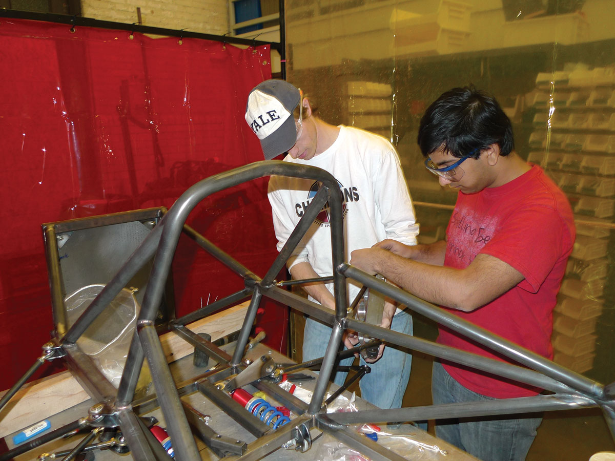 Belter and Jaju test-fit the uprights on the welded chassis.