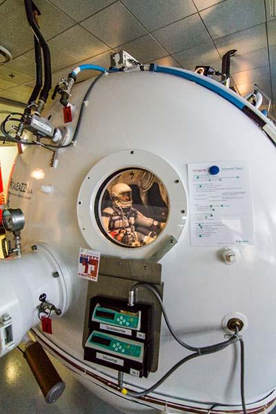 Cameron M. Smith of Pacific Spaceflight / Copenhagen Suborbitals in the Mark I 'Gagarin' Pressure Garment in the Copenhagen University Hospital Altitude Chamber. Photo: Jev Olsen, Copenhagen Suborbitals.