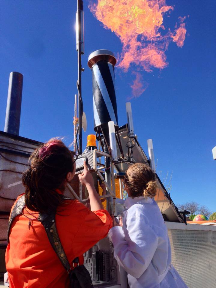 Tina Merrie explaining to students the Mars Rover Art Car fire effect operation. Image Credit: Charles White