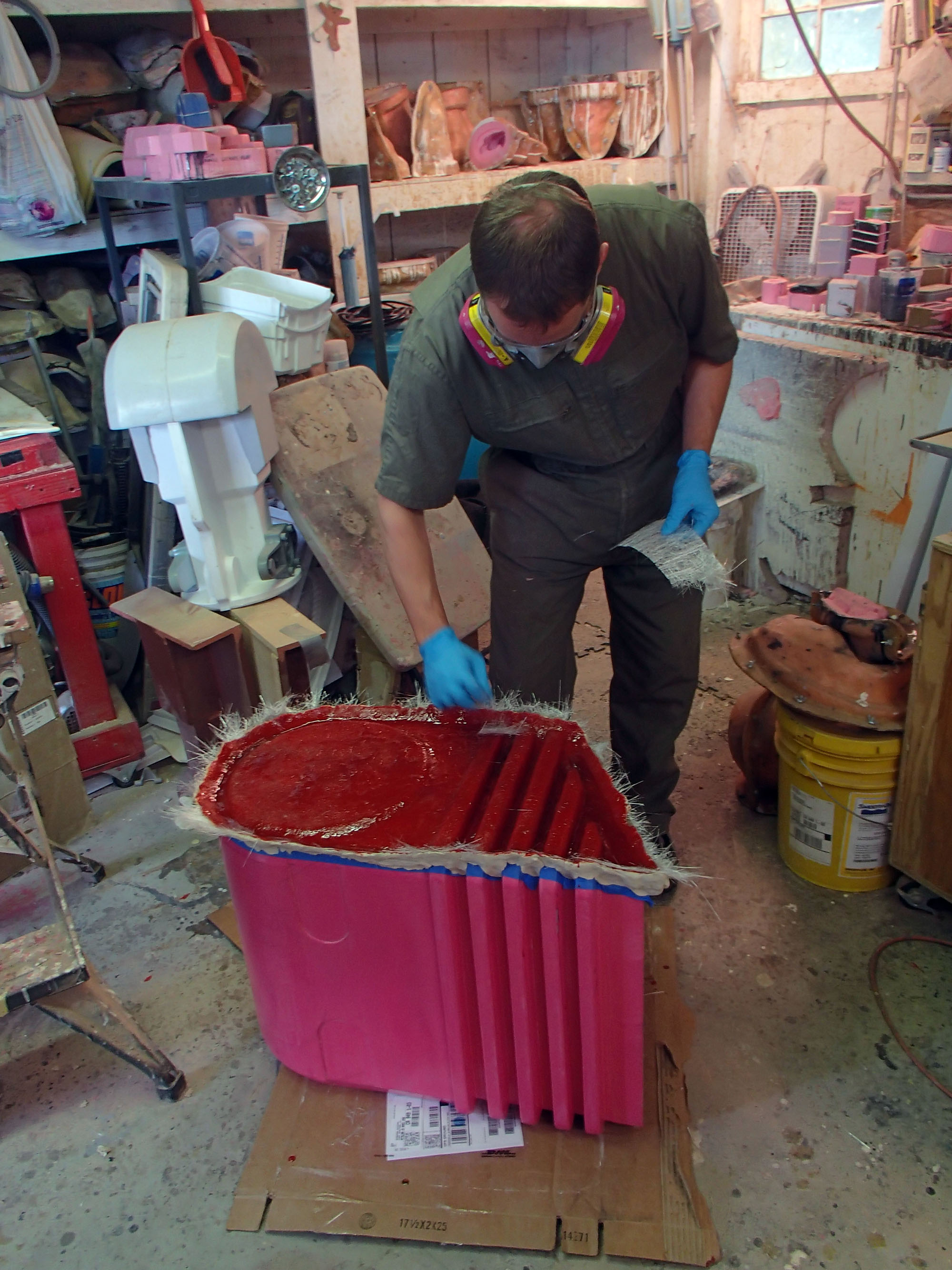 Trevor laying up gelcoat on the beginning of the pelvis mold.