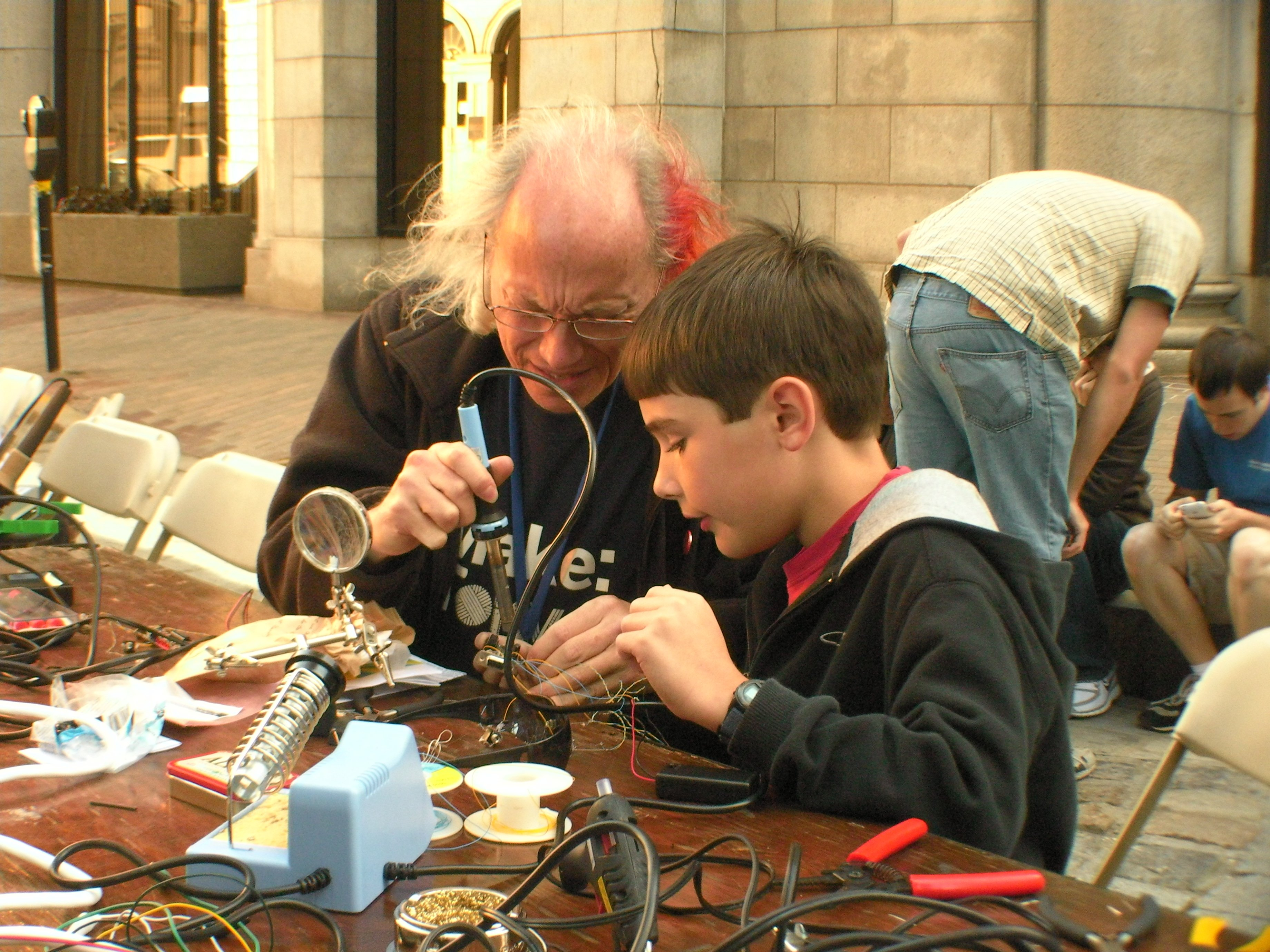 Mitch Altman Teaches Soldering at the first Rhode Island Mini Maker Faire. Photo Credit: Becky Stern