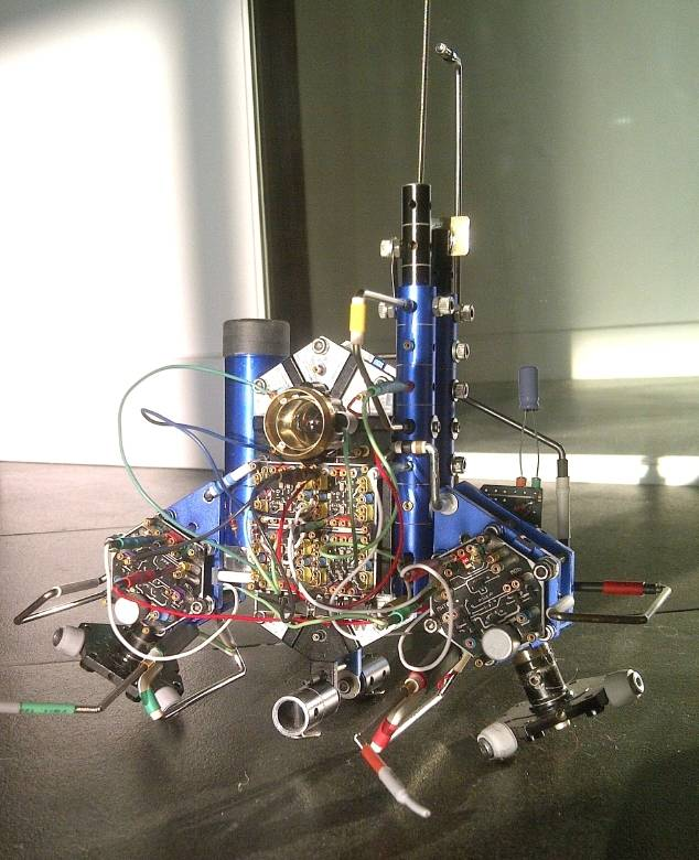 The finished 15cm tall robot (30cm with antennae) sporting a sample Braitenberg-style follow-the-light-avoid-the-object configuration.