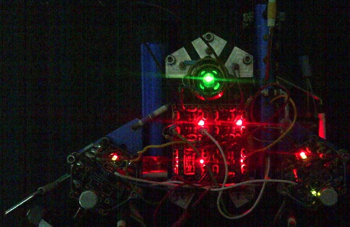 An active running experiment showing process patterns in the dark. The green eye LED allows me to find it when it gets trapped under chairs or tables.