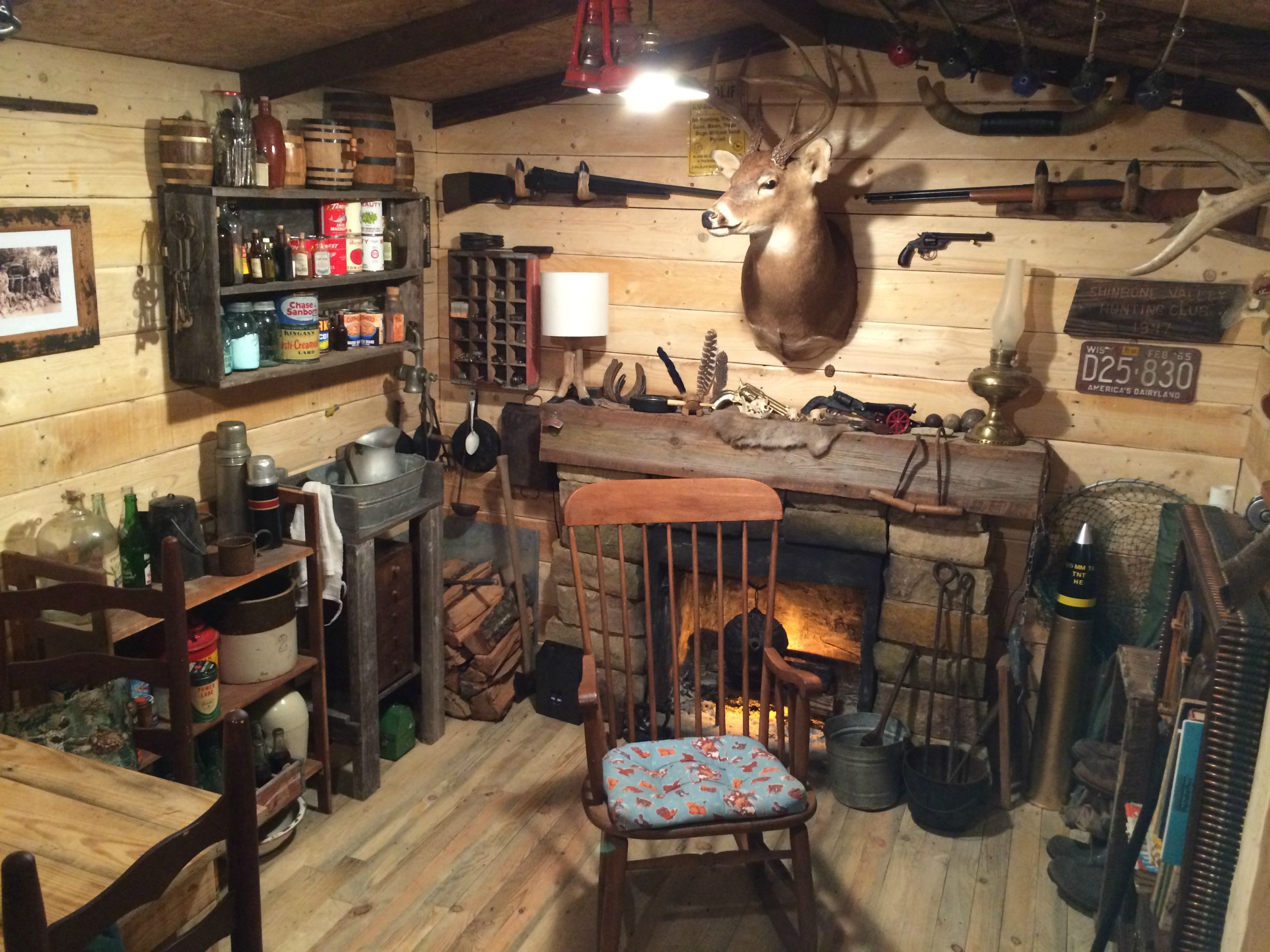 Man turns unused basement room into a log cabin replica for Log cabin basement ideas