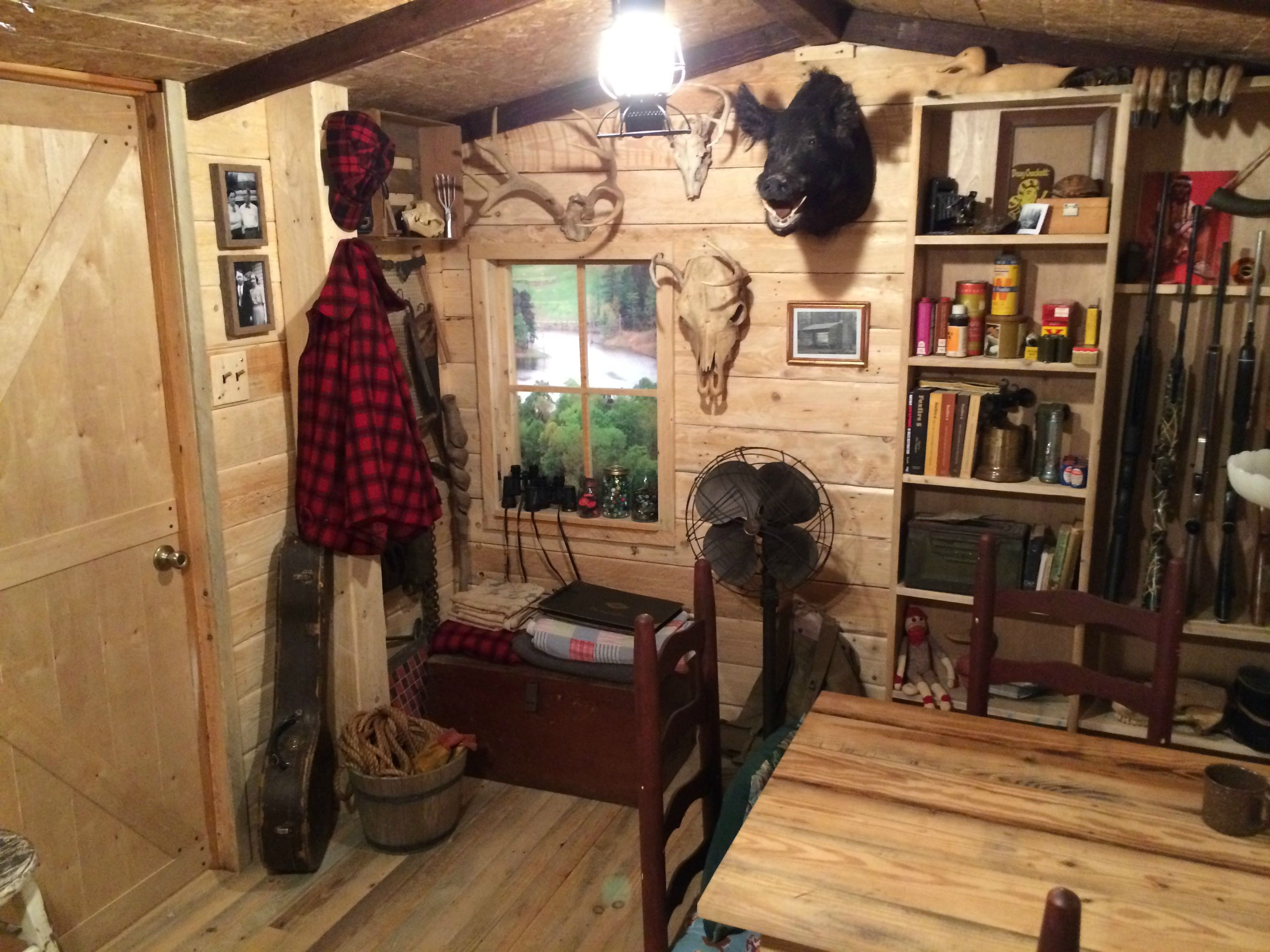 Man turns unused basement room into a log cabin replica | Make: