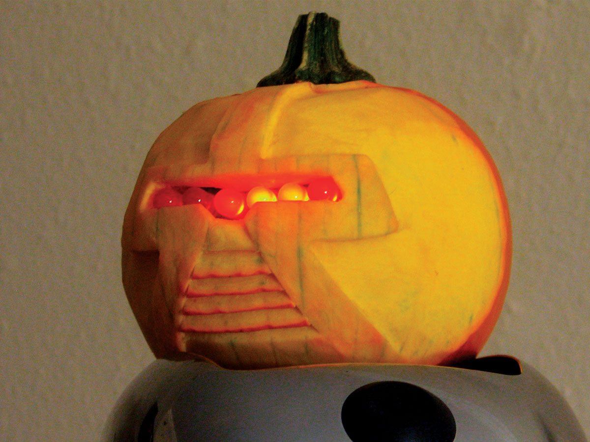 This pumpkin may actually be a Cylon. It has six 10mm LEDs. For a giant Cylon (above), replace each LED with 4 in series, and omit the 330Ω resistor.