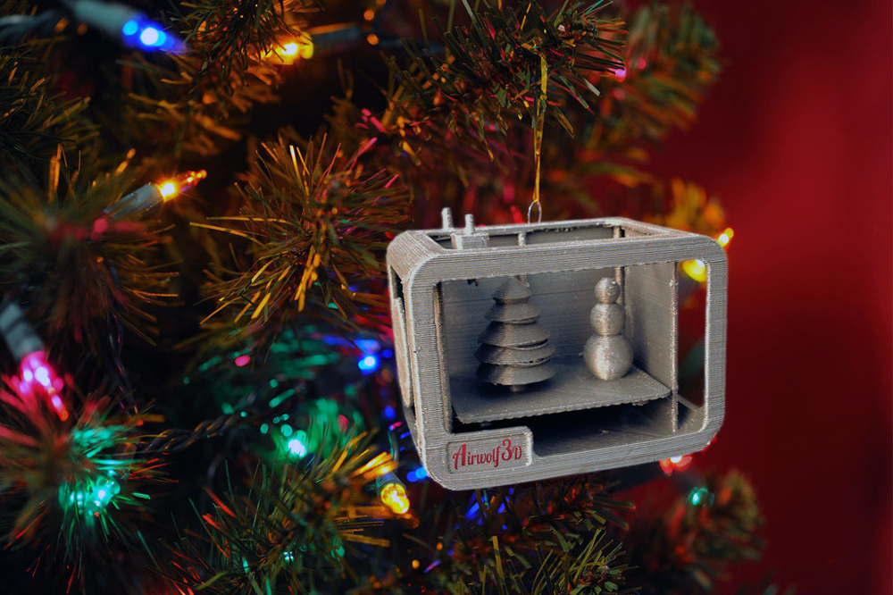 The irony isn't lost on StemenInc's 3D printed 3D Printer Christmas Ornament, which features a 3D printer printing Christmas ornaments. StemenInc designed the ornament using an Airwolf 3D printer for the 2014 White House Ornament Design Contest. Unfortunately, the design didn't win but that doesn't take away from its uniqueness.