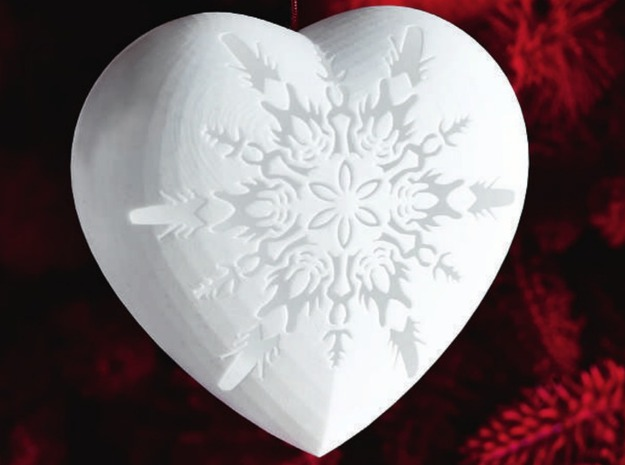 Tis the season to be giving (or getting) and nothing say's 'give me more' like Helen & Colin David's Small Snowflake 3D printed heart. HeyKing3D designed the ornament in collaboration with the couple mentioned above for the Christmas Tree collaboration featured at London's Victoria and Albert Museum. There is a small hole in the top of the heart that can be used to hang the ornament or filled with LEDs for a truly interesting look