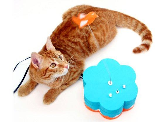 Mark de Vinck's Kitty Twitty Cat Toy sends Twitter updates to the internet when the cat engages the toy bird. Cats can send Tweets by 'paw slapping' the toy bird, which sits atop a guitar string that's connected to an Arduino. The Arduino sends the cat's status using an Ethernet cable connected to the internet. Depending on the cat's mood, users could find their inbox spammed with Twitter updates.