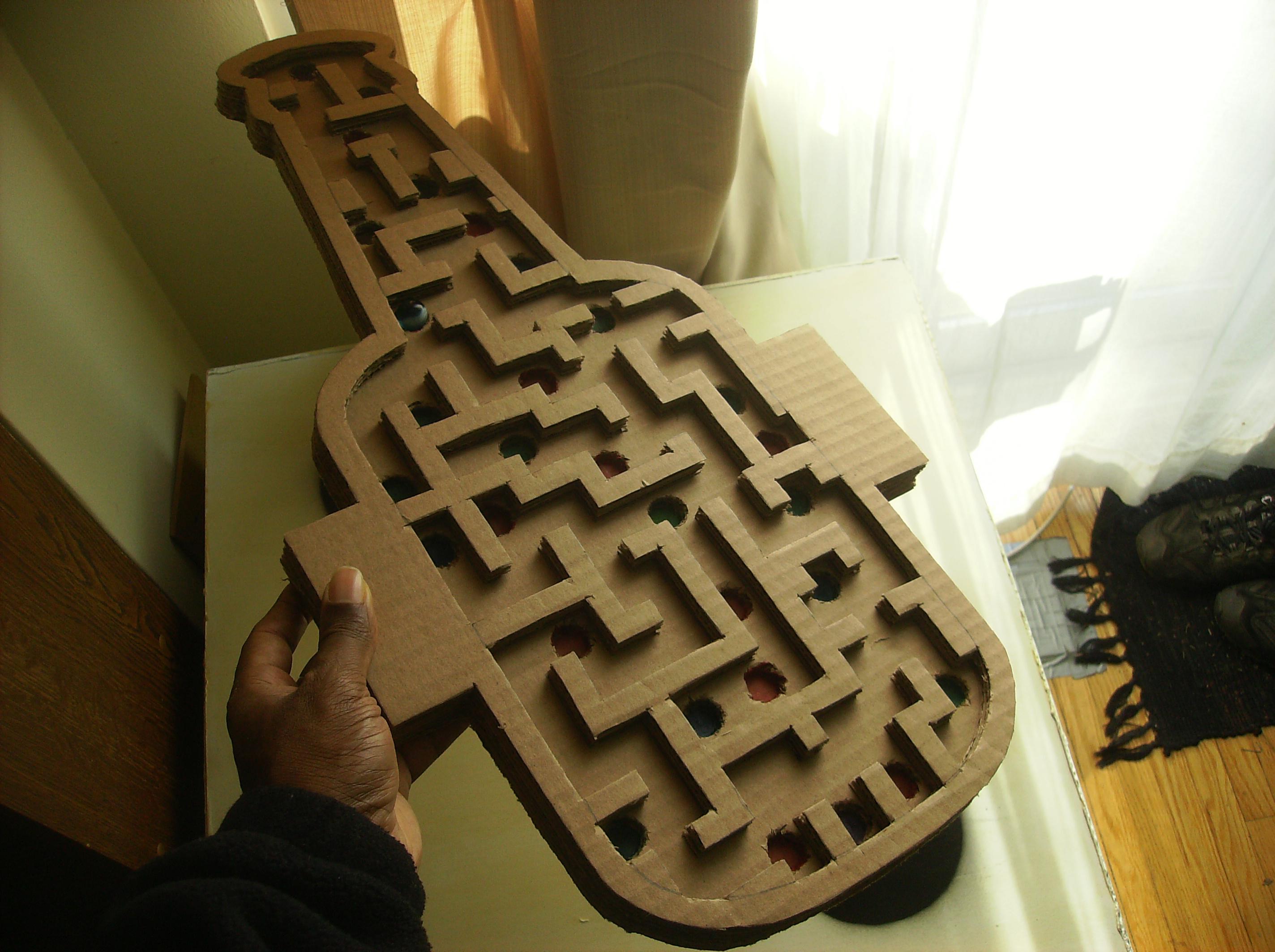 The handheld handmade marble maze game