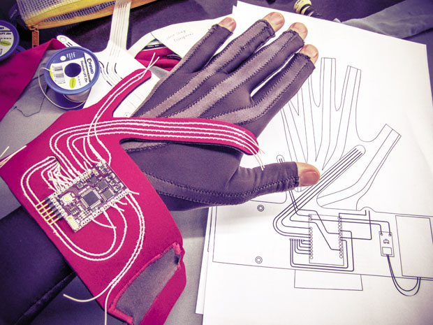 """""""The Gloves Project"""" uses flex sensors to create experimental gestural music; the project is developed by Rachel Freire, Imogen Heap, Seb Madgwick, Tom Mitchell, Hannah Perner Wilson, Kelly Snook, and Adam Stark."""