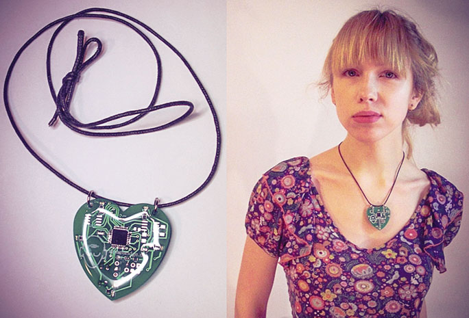 """""""Heart Spark"""" by Eric Boyd is a custom-designed, printed circuit board necklace that receives a signal from a Polar heart rate monitor band and blinks in unison with the wearer's heartbeat."""