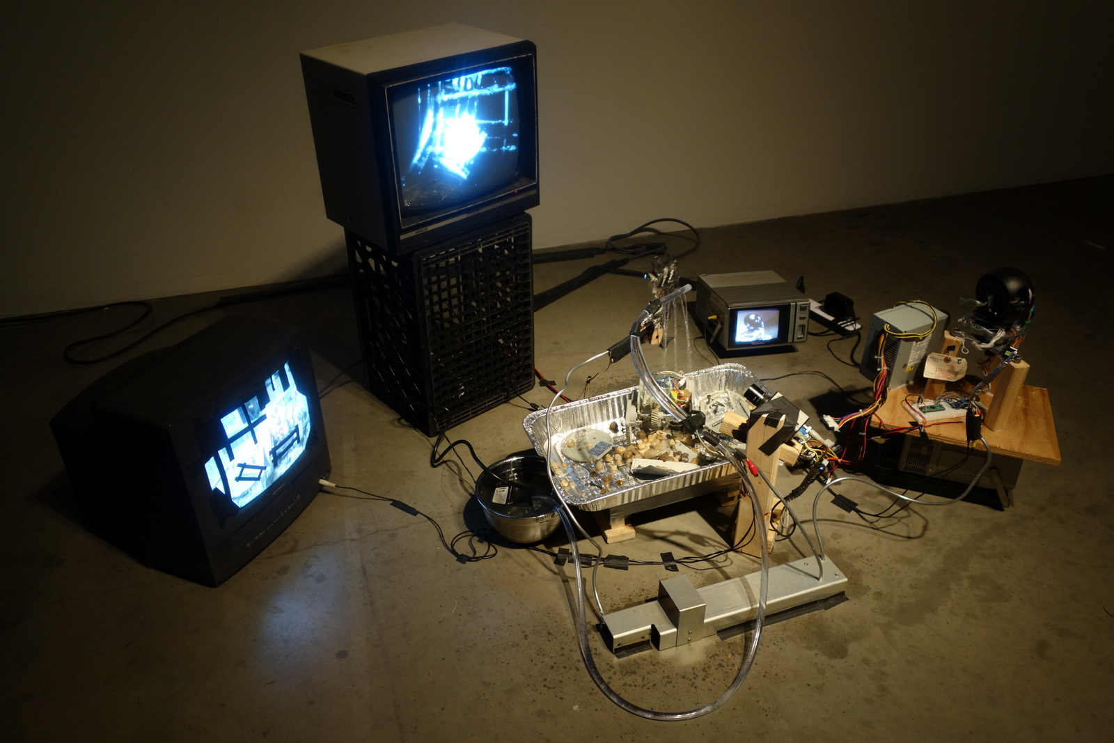 Last Robot Left Alive by Bradley Rothenberg and Adam Mayer. The installation postulated the resurrection of a broken security camera that fell to the ground likely due to wind sheer from Hurricane Sandy.