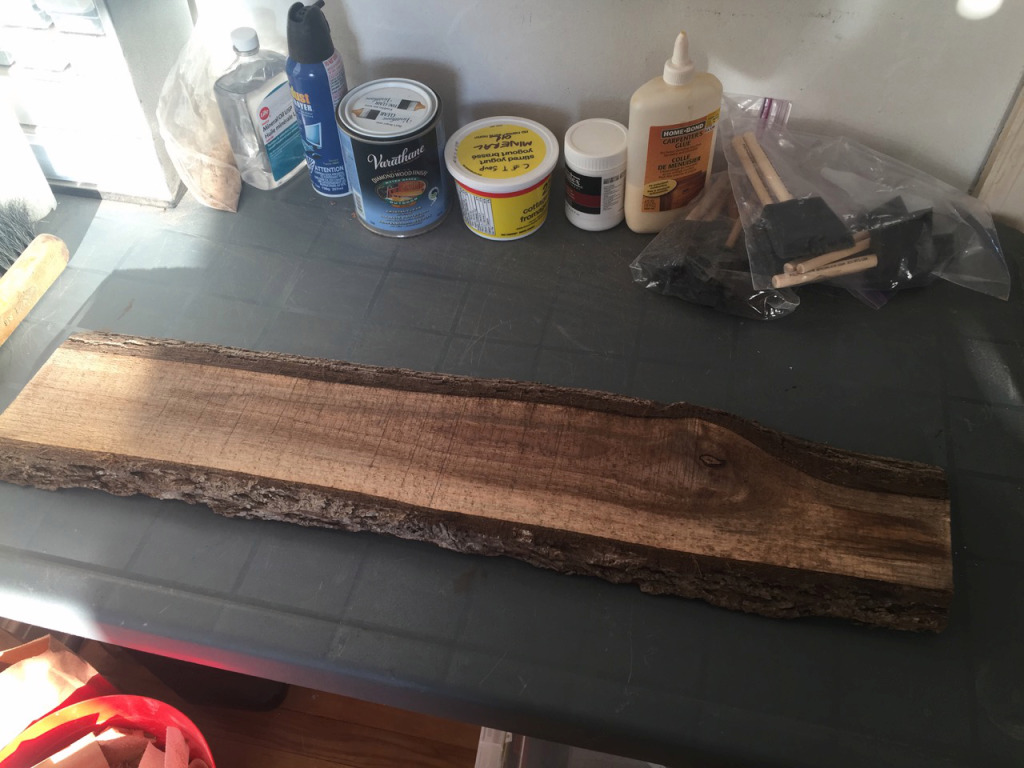 I started with a rough cut black walnut board. It was harvested locally and special care was taken to preserve the bark for a natural look.